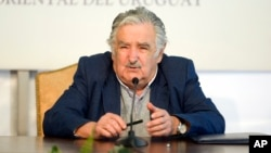 FILE - Uruguay's President Jose Mujica speaks during a news conference at the presidential house Residencia de Suarez y Reyes, in Montevideo, Uruguay, Sept. 12, 2014.