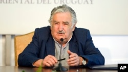 FILE - Uruguay's President Jose Mujica speaks during a news conference the presidential house Residencia de Suarez y Reyes, in Montevideo, Sept. 12, 2014.