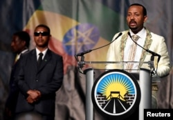 "FILE - Ethiopia's Prime Minister Abiy Ahmed addresses his country's diaspora, the largest outside Ethiopia, calling on them to return, invest and support their native land with the theme ""Break The Wall Build The Bridge"", in Washington, July 28, 2018."