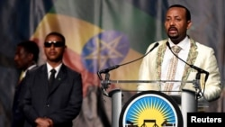 """Ethiopia's prime minister, Abiy Ahmed, addresses his country's Washington-based diaspora, the largest outside Ethiopia, calling on them to return to, invest in and support their native land with the theme """"Break the Wall, Build a Bridge,"""" in Washington, July 28, 2018."""