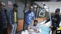 나토 공습 후 트리폴리 내 병원으로 이송된 부상자