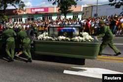 Soldiers push the vehicle and trailer carrying the ashes of the late Cuban leader Fidel Castro after suffering a mechanical issue in Santiago de Cuba, Cuba, Dec. 3, 2016.