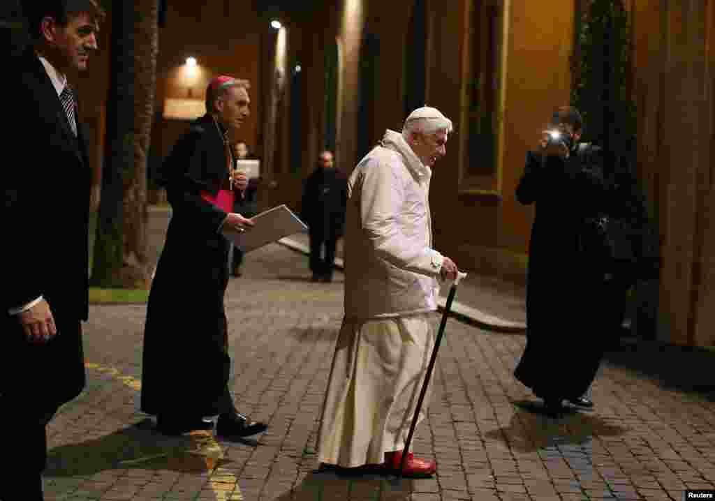 Pope Benedict arrives to attend a meeting with seminarians at the Romano Maggiore seminary in Rome, February 8, 2013.