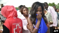 Students evacuated from Moi University during a terrorist seige react as they gather together in Garissa, Kenya, before being transported to their home regions, April 3, 2015.