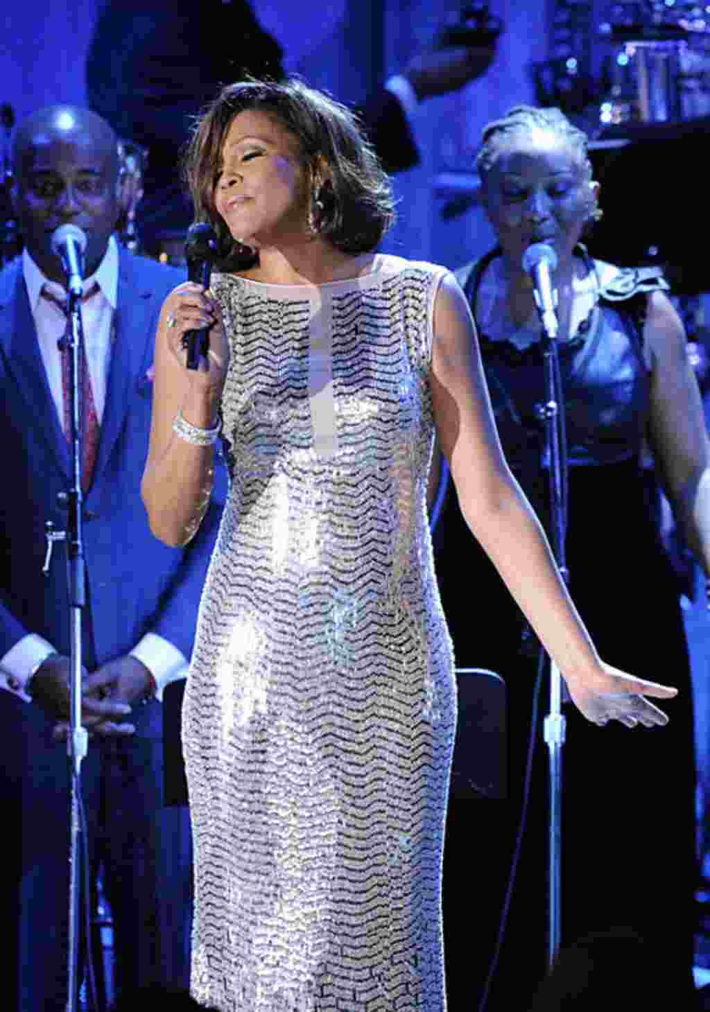 In this February 13, 2011 file photo, singer Whitney Houston performs at the pre-Grammy gala in Beverly Hills, California. (AP)