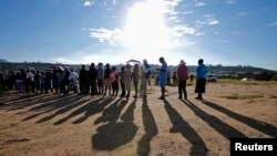 Locals wait to cast their votes during Lesotho's national elections in Magkhoakhoeng village, outside the capital, Maseru, Feb. 28, 2015.
