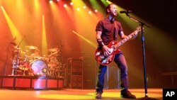 Alternative metal band Godsmack performs on August 7, 2013, in Bethlehem, Pa. (Photo by Owen Sweeney/Invision/AP)