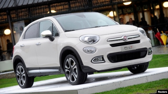 FILE - The FIAT 500x model is seen during the official presentation in Balocco, northern Italy, Nov. 11, 2014. German environmental lobby group DUH accusing Fiat Chrysler Automobiles' 500X compact sport-utility vehicle of releasing excessive levels of toxic diesel emissions.