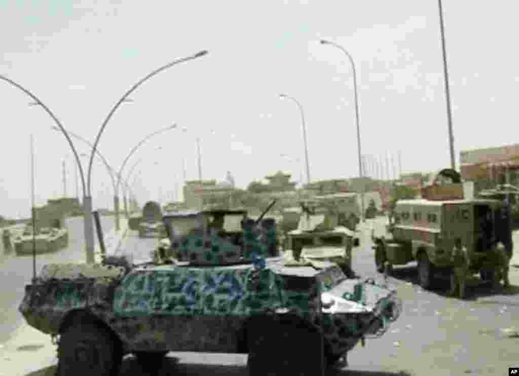 This image taken from video obtained from the Iraqi Military shows armored and military vehicles during clashes in the northern city of Mosul, Iraq, June 9, 2014.