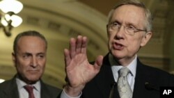Senate Majority Leader Harry Reid (D-NV) speaks to the media on U.S. budget talks next to Sen. Charles Schumer (D-NY) on Capitol Hill in Washington (file photo)