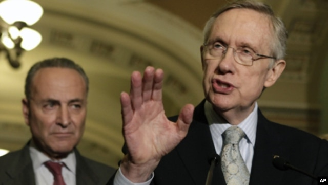 Senate Majority Leader Harry Reid (D-NV) speaks to the media on U.S. budget talks next to  Sen. Charles Schumer (D-NY) on Capitol Hill in Washington (file photo)