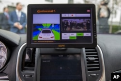 A display inside a Tesla Model 90D during a demonstration of car technology on Capitol Hill in Washington, March 15, 2016.