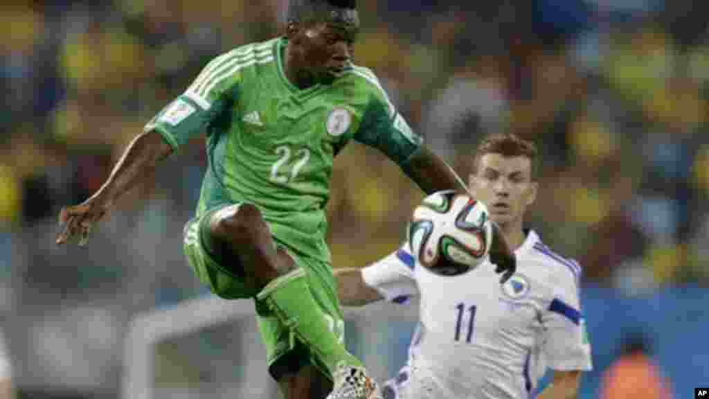 Nigeria's Kenneth Omeruo clears the ball from Bosnia's Edin Dzeko.