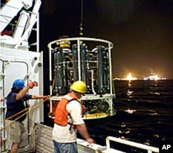 Sampling device being lowered from the Endeavor research vessel.