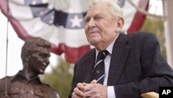 Griffith near bronze statue of Andy and Opie from 'The Andy Griffith Show,' Raleigh, N.C., Oct. 28, 2003.