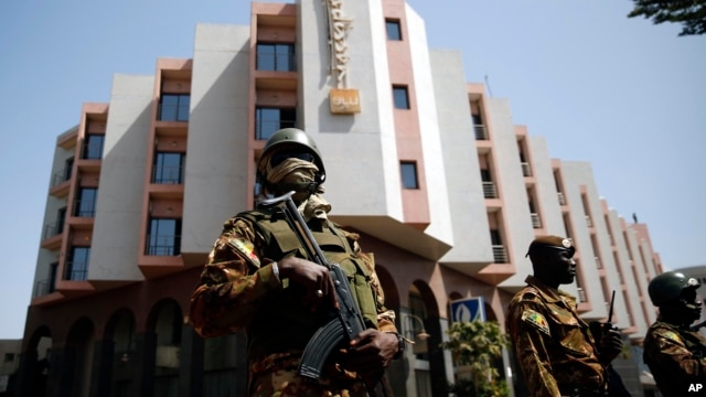 FILE - Tight security surrounds the Radisson Blu hotel after al-Qaida launched a deadly attack on guests in Bamako, Mali, Nov. 20, 2015.