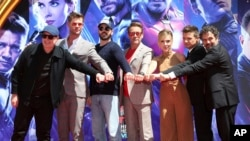 "Marvel Studios President Kevin Feige, from left, poses with members of the cast of ""Avengers: End Game,"" Chris Hemsworth, Chris Evans, Robert Downey Jr., Scarlett Johansson, Jeremy Renner and Mark Ruffalo at TCL Chinese Theatre."