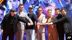 "FILE - Marvel Studios President Kevin Feige, from left, poses with members of the cast of ""Avengers: End Game,"" Chris Hemsworth, Chris Evans, Robert Downey Jr., Scarlett Johansson, Jeremy Renner and Mark Ruffalo at the TCL Chinese Theatre, April 23, 2019, in Los Angeles. (AP)"