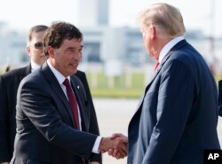 President Donald Trump is greeted by 12th Congressional District Republican candidate Troy Balderson as he arrives on Air Force One at John Glenn Columbus International Airport in Columbus, Ohio, Aug. 4, 2018.