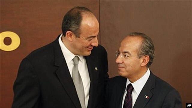 Mexico's President Felipe Calderon, right, stands with his former Attorney General Arturo Chavez Chavez at Los Pinos presidential residence in Mexico City, March 31, 2011