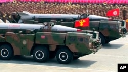 Military trucks carrying a missile parade the streets during a ceremony marking the 60th anniversary of the Korean War armistice in Pyongyang, North Korea, Saturday, July 27, 2013. (AP Photo/KRT via AP Video)