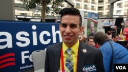 "Julian Del Real-Calleros of Los Angeles is sticking with John Kasich, even though he's a distant third in the GOP race. ""I'm supporting the guy who I believe is the perfect next president,"" he says. (M. O'Sullivan/VOA)"