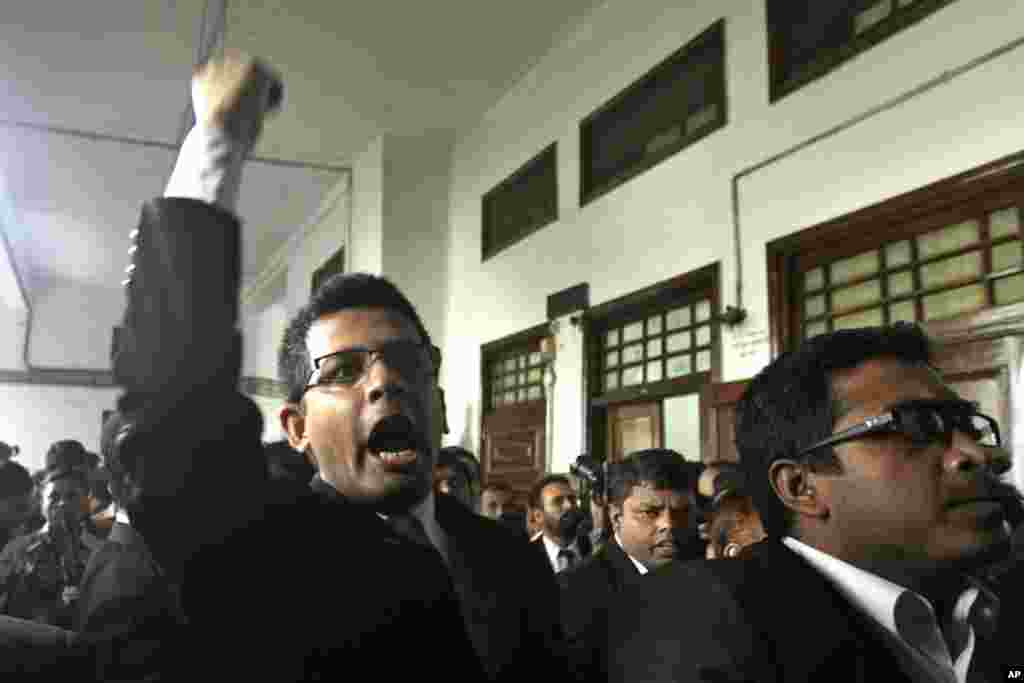 Lawyers of the main opposition Bangladesh Nationalist Party protest after the Supreme Court cleared the way for the execution of Abdul Quader Mollah, an opposition leader convicted of war crimes in Dhaka, Dec. 12, 2013.