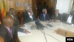 Ignatius Chombo and other state officials addressing the press in Harare on Tuesday.