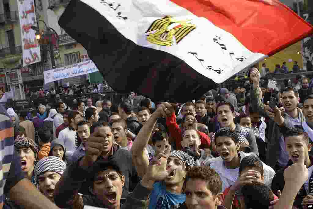 Egyptian protesters shout anti-military ruling council slogans during a protest at Tahrir Square, Cairo, November 27, 2011. (AP)