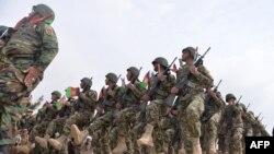 Abasirikare ba Afuganistani mu birori mw'ikambi ya gisirikare muri distrikte ya Guzara mu ntara ya Herat. Italiki 28/02/2019.