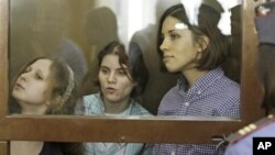 Members of punk group Pussy Riot on trial in glass-enclosed courtroom cage, Moscow, July 30, 2012.