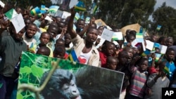 Residents from the local community attend a baby gorilla naming ceremony in Kinigi, northern Rwanda, Sept. 5, 2015.