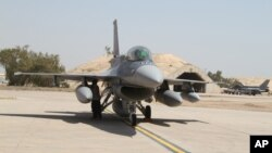 FILE - U.S.- made F-16 fighter jets stand on the tarmac upon their arrival to Balad air base, 75 kilometers (45 miles) north of Baghdad, Iraq.