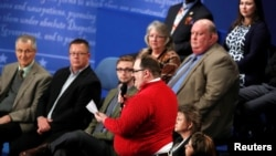 Ken Bone, a power plant employee from Belleville, Illinois stands to ask a question about energy policy and jobs to Republican U.S. presidential nominee Donald Trump and Democratic nominee Hillary Clinton during their presidential town hall debate at Wash