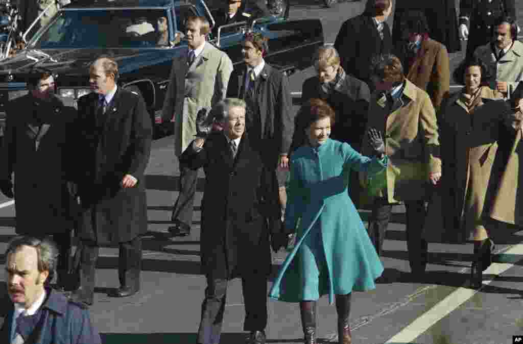 In this Jan. 20, 1977 file photo, President Jimmy Carter and First Lady Rosalynn Carter walk to the White House after being sworn in as the 39th president.