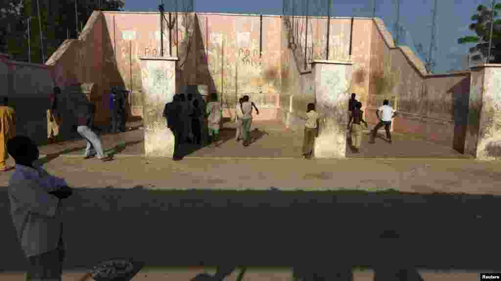 Youths play the Eton fives game in a court in the city of Katsina.