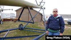"Ron Gruenhagen, a farmer from Muscatine, Iowa, says U.S. farmers are very dependent on foreign markets. ""If we didn't have them we would be flooded with grain and soybeans and maybe we wouldn't know what to do with it,"" he said."