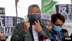 支联会主席李卓人因8-18流水式集会案及8-31祈祷游行案,被判监禁14个月。 (美国之音 汤惠芸)