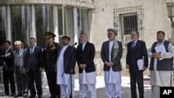 Afghan President Hamid Karzai (C), with his vice presidents and some key cabinet members, gives a speech regarding the U.S. plan to withdraw troops from Afghanistan, in Kabul June 23, 2011