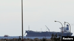 FILE - The North Korean-flagged tanker 'Morning Glory' docked at the Es Sider export terminal in Ras Lanuf, March 8, 2014.