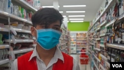 Phorn Phoan, 21, who works at Super Duper supermarket talks about the masks-only rules since the COVID-19 outbreak, Phnom Penh, Cambodia, March 28, 2020. (Khan Sokummono/VOA Khmer).