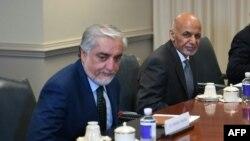 Afganistan Cumhurbaşkanı Eşref Gani (sağda) ve Afganistan Milli Uzlaşı Yüksek Konseyi Başkanı Abdullah Abdullah (solda)