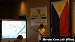 "Mayor Eugenio Bito-onon of the Kalayaan Group of Islands, the Philippines-controlled Spratly Islands, points out the Philippines' claims in the Spratlys during a fundraising dinner to gain support for a proposed ""ecotourism zone."""