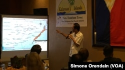 "Mayor Eugenio Bito-onon of the Kalayaan Group of Islands, the Philippines-controlled outcroppings in the Spratly Islands, points out the Philippines' claims in the Spratlys during a fundraising dinner to gain support for a proposed ""ecotourism zone"" in th"
