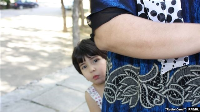 As many Tajik children lose both their parents to labor migration, this is placing an increasing burden on other family members left behind to look after them. (File Photo)