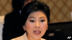 Thailand's Prime Minister Yingluck Shinawatra speaks during her meeting with election commissioners at the Army Club, Jan. 28, 2014 in Bangkok)