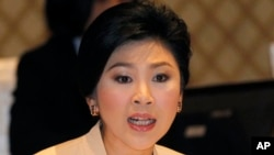 Thailand's Prime Minister Yingluck Shinawatra speaks during her meeting with election commissioners at the Army Club, Jan. 28, 2014 in Bangkok