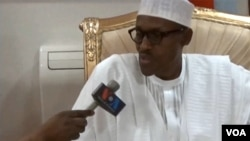 FILE - Nigerian President Muhammadu Buhari is interviewed by VOA's Aliyu Mustapha, June 12 in Abuja, Nigeria.