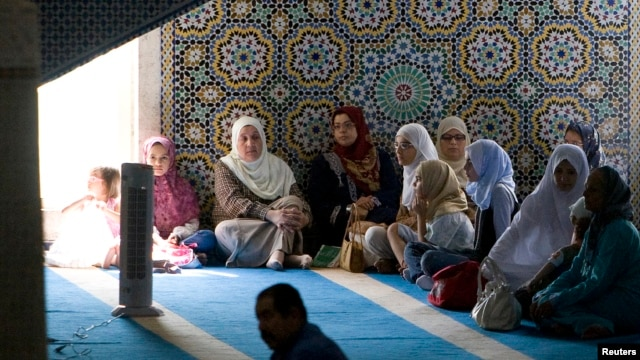FILE - Muslim women gather for the first Friday prayers of the holy month of Ramadan in Rome's mosque, Sept. 5, 2008.