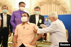 Thailand's Prime Minister Prayuth Chan-ocha receives an injection of the AstraZeneca coronavirus disease (COVID-19) vaccine at the Government House in Bangkok, Thailand, March 16, 2021.